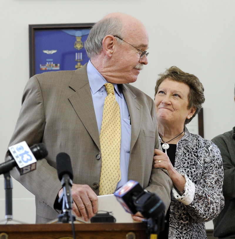 Joe Gray, 66, and his wife, Marie, share a moment after his retirement announcement Tuesday. They decided during a recent trip to Greece for their 40th anniversary that it was time for him to step down.