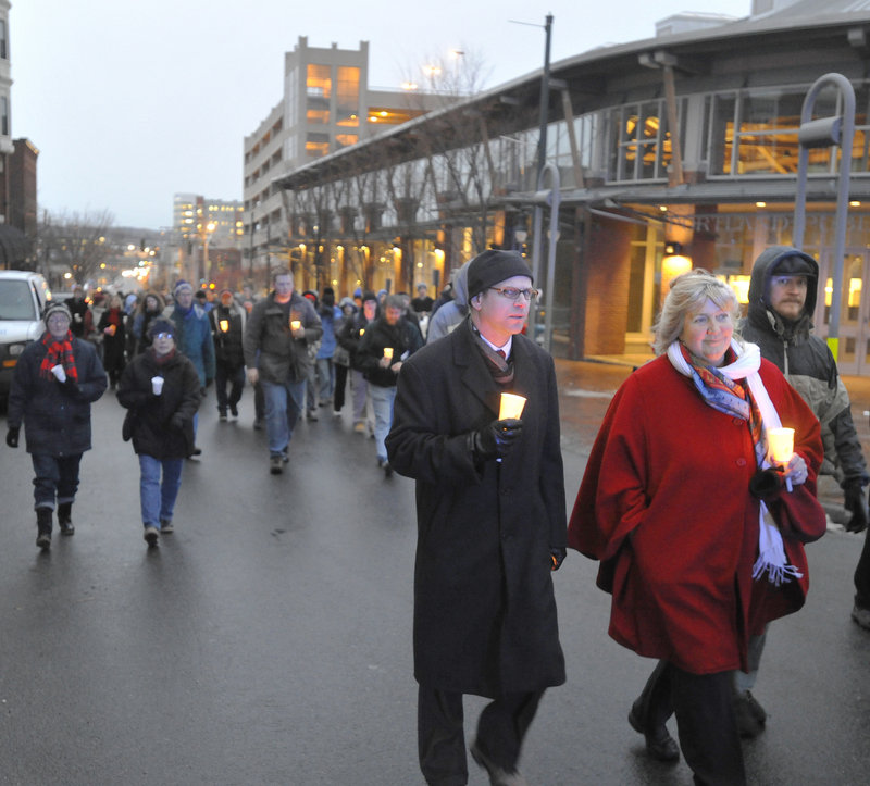 A procession in honor of homeless people who have died heads from the Preble Street Resource Center to Monument Square on Tuesday.