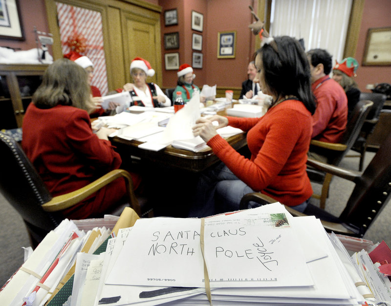 Postal workers sort Dear Santa letters Wednesday at the post office on Forest Avenue in Portland.