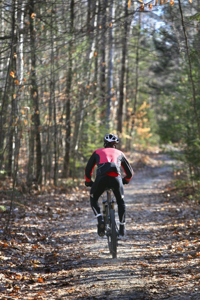 A mountain biker rides along Link Trail in Bradbury Mountain State Park earlier this month. A reader is unhappy with a proposal to expand the corridors available to bikers.