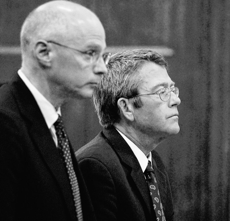 John D. Duncan, right, stands with his attorney Toby Dilworth as he is sentenced in Cumberland County Superior Court in Portland. Several of Duncan's former partners at Verrill Dana still face possible sanctions.