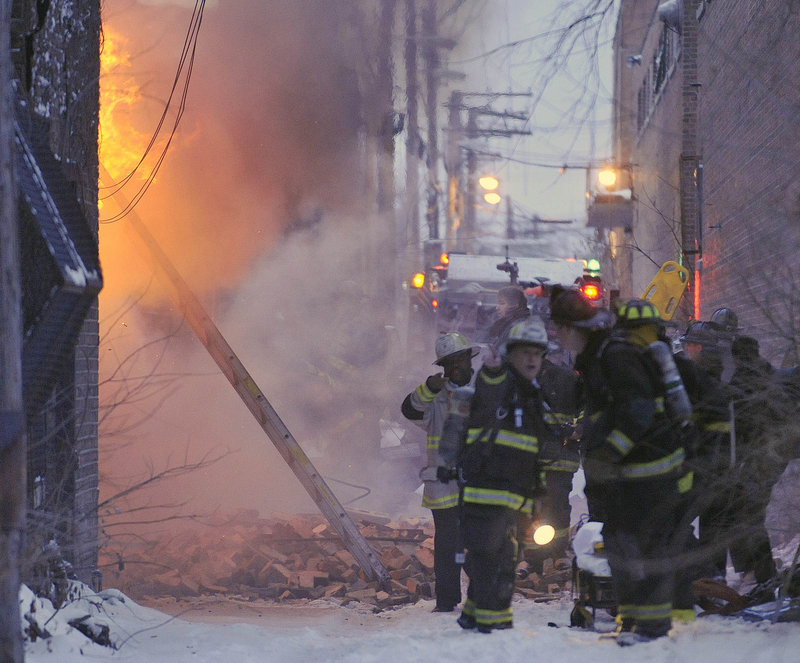 Chicago firefighters battle a blaze Wednesday at an abandoned building on the city's South Side. What was expected to be a routine winter fire left two firefighters dead after the roof and a wall collapsed.