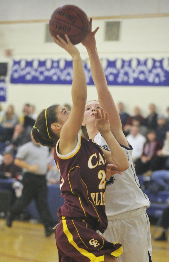 Emma O'Rourke of Cape Elizabeth heads to the basket Wednesday night as Sean Cahill of Yarmouth goes for the blocked shot. Cahill was called for a foul on the play. Cape Elizabeth emerged with a 44-21 victory.