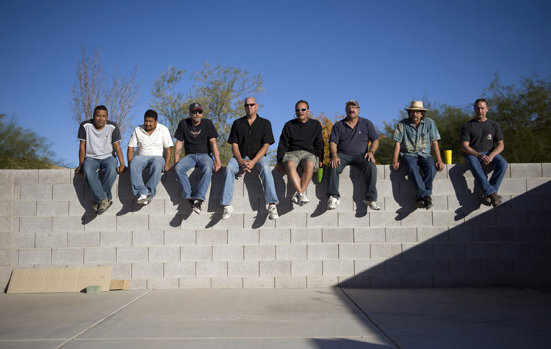 Alberto Pott, Madelio Vaca, Larry Wayland, Chad Wallace, Tony Kuberski, Art Fisher, Jim Brown and Mike Davis are pictured at Brown's home in Henderson, Nev. All eight of the carpenters worked on the CityCenter project before being laid off because of the recesssion.