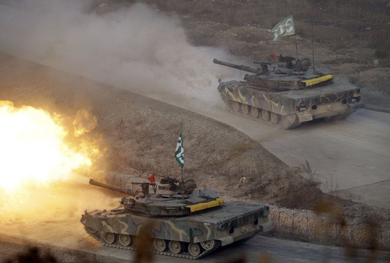 """South Korea K-1 tanks fire live rounds on the Seungjin Fire Training Field in Pocheon, 20 miles from the Koreas' heavily fortified border, on Thursday. North Korea condemned the drills as """"a grave military provocation."""""""