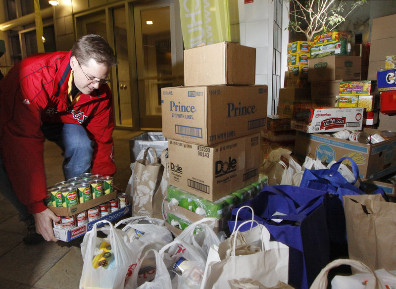 Jim McDermott of North Hampton, N.H., drops off food at USM's Abromson Center, where the Next Level Church was taking donations for the Wayside Food Rescue Program.