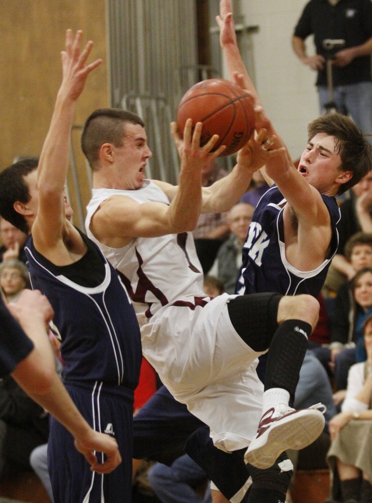 Sam Johnston, who scored 29 points Thursday night for Greely in a 67-49 victory against York, is fouled by Liam Langaas, right, while on a drive. The Rangers reached 6-0 and dropped the Wildcats to 4-2.