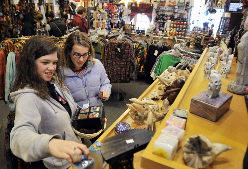 "Lynsie Peters and Elise Alves, both of Portland, browse at Mexicali Blues in the Old Port on Friday. ""I want to take as long as possible to find the perfect gift,"" Alves said."
