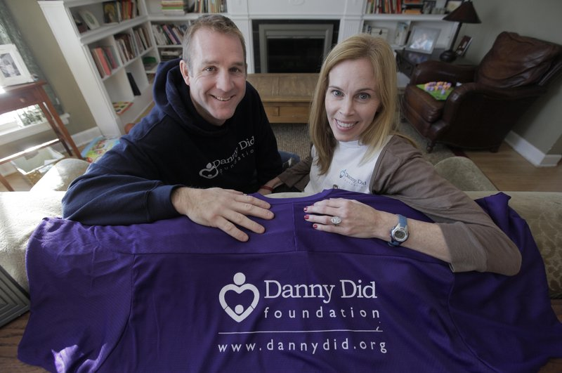 Michael and Mariann Stanton sit in their Chicago home Dec. 8 with items from the foundation they created in memory of their son Danny. Since the 4-year-old's death from an epileptic seizure last year, they've worked to raise awareness of a rare condition called Sudden Unexplained Death in Epilepsy and raised thousands of dollars for specialized monitors.