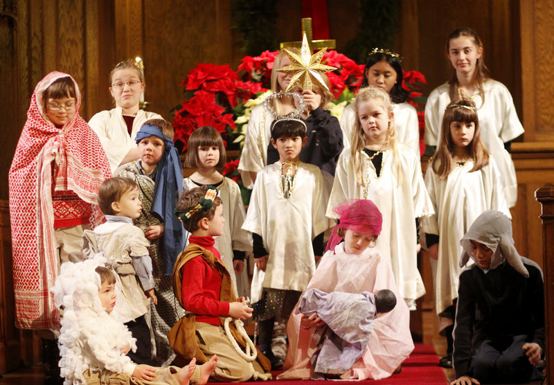 Eight-year-old Sarah Thayer of Portland holds the baby Jesus while playing Mary in the Nativity scene at the Christmas Eve service at Immanuel Baptist Church in Portland.