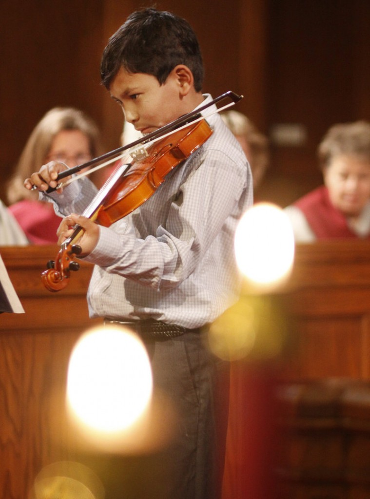 Dipesh Cyr-Brophy, 9, of South Portland plays a Christmas medley.