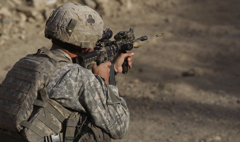 Sgt. Benjamin Olivarez of Kingsville, Texas, a member of the 2nd Platoon Bravo Company 2-327 Infantry, tests his weapon Thursday in eastern Afghanistan. A troop surge to roll back the Taliban has resulted in more U.S. combat deaths.
