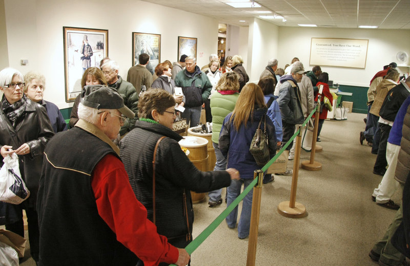 Shoppers line up with returns and exchanges at L.L. Bean in Freeport on Sunday. Other shoppers were out looking for bargains.