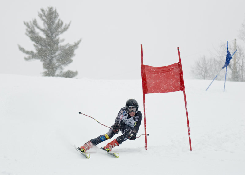 Alex Rose cruises past a gate at the Class C meet at Lonesome Pine Trails in Fort Kent. Rose swept both Alpine titles in the February meet, repeating his sweep of the 2009 titles.