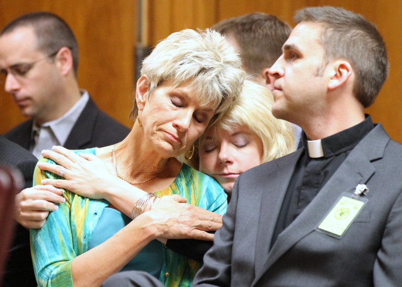 Jeanne Tiller, widow of slain abortion doctor George Tiller, receives a hug from a family member during Scott Roeder's sentencing. A federal probe seems to be focusing on a Bible study group that Roeder attended.