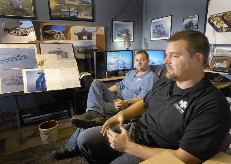 Michael Howe, in back, and Geoff Howe decided to build the rugged Ripchair after getting an e-mail from a disabled veteran who wanted a chair that would allow him to fish in the woods.