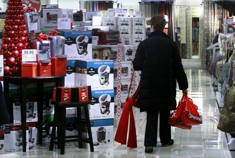 The Associated Press A shopper eyes cookware at the J.C. Penney store at Herald Square in New York. A new survey shows consumer confidence dipped in December, even after other reports suggest people increased their holiday spending.