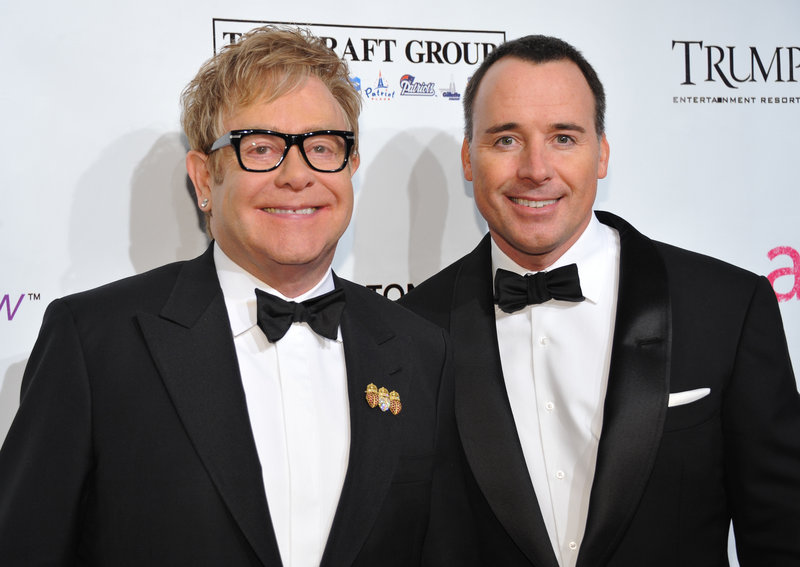 Sir Elton John, left, and partner David Furnish attend the Elton John AIDS Foundation benefit in New York on Oct. 18. John and Furnish have become parents of a 7-pound, 15-ounce baby boy born on Christmas Day in California.