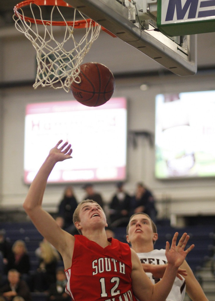 Ben Burkey of South Portland, gaining inside position for a rebound against Greely later in the day, was one of the players who benefited from playing time in the early game, scoring 19 points against Mountain Valley.