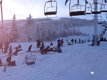 Some chairs lie on the ground while others are suspended in the air after the Spillway East lift derailed Tuesday morning at Sugarloaf. About 150 people were stranded when the 4,000-foot-long chairlift stopped and had to be lowered to the ground by ropes, a resort official said.