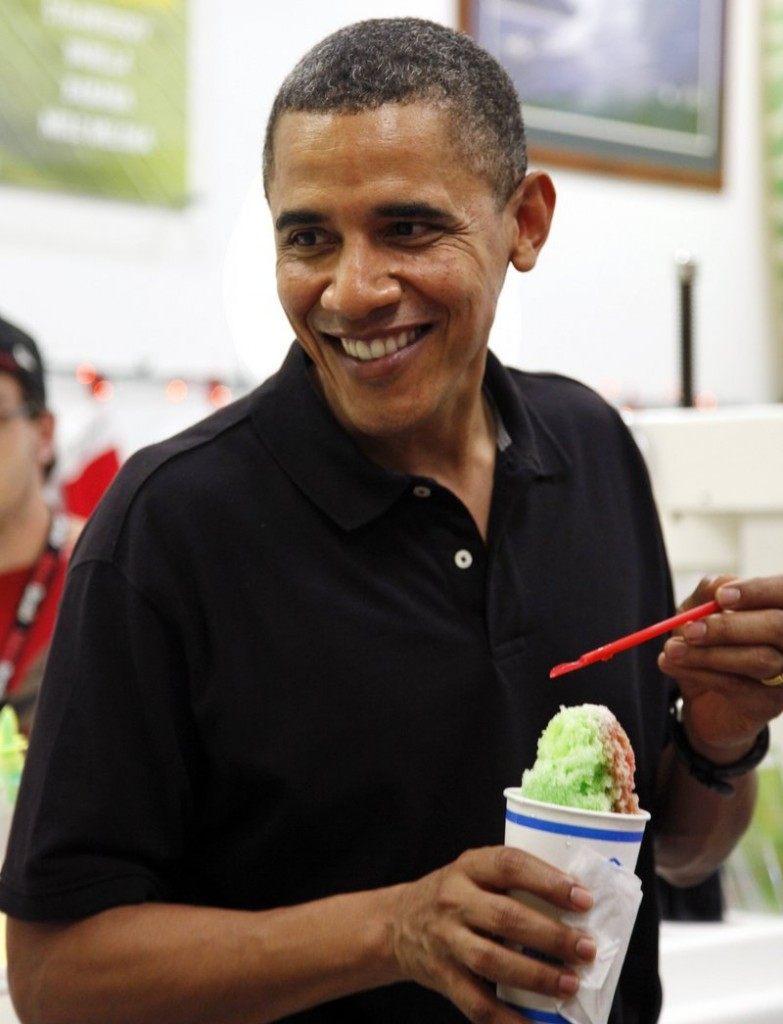 President Obama smiles Monday while enjoying shaved ice at Kailua Beach Center while on vacation.