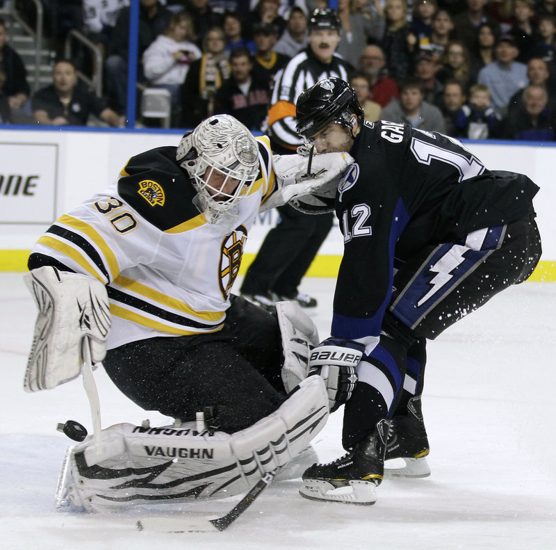 Bruins goalie Tim Thomas (31 saves) stops a shot by Tampa Bay's Simon Gagne on Tuesday night in Tampa, Fla. Mark Recchi's goal with 19.7 seconds left gave Boston a 4-3 win that pushed the Bruins into the Northeast Division lead, two points up on Montreal.