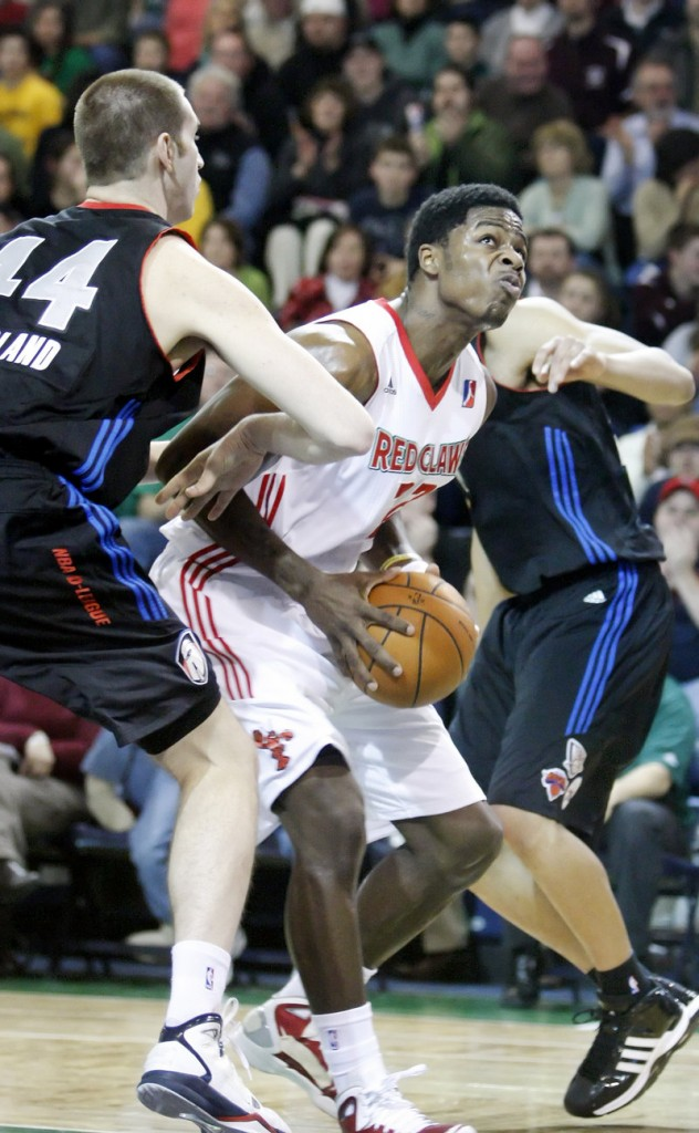 DeShawn Sims of the Maine Red Claws attempts to slip past Chas McFarland of the Springfield Armor during the Red Claws' 114-103 victory Tuesday night at the Expo.