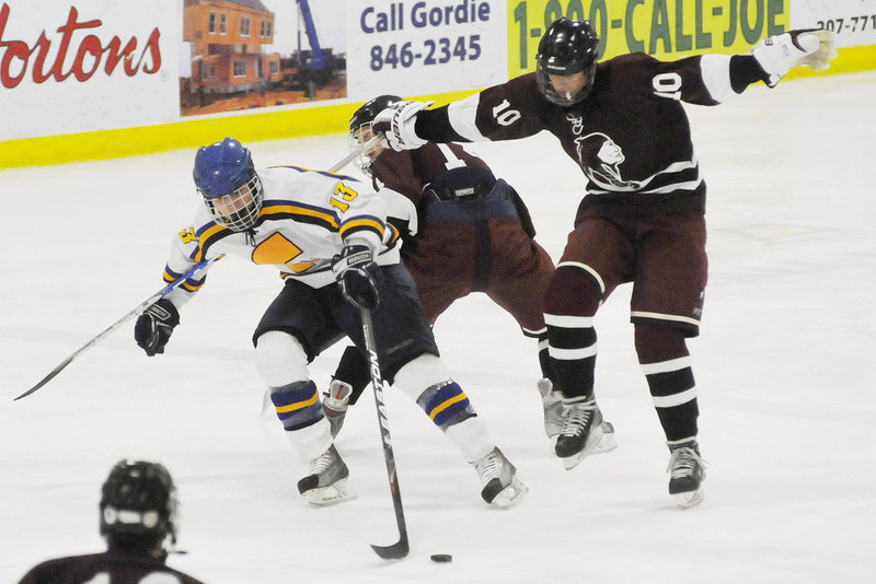 Brandon Tuttle of Falmouth reaches for the puck against North Haven, Conn. The tournament has grown from six teams to 38, including 18 from out of state.