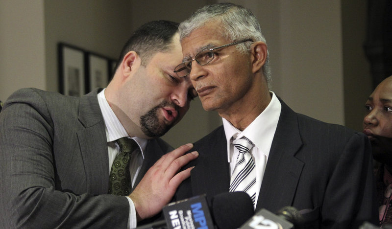 Attorney Chokwe Lumumba, right, and NAACP National President Benjamin Jealous confer during a news conference about the pending release of sisters Gladys and Jamie Scott at the Capitol in Jackson, Miss., on Thursday.