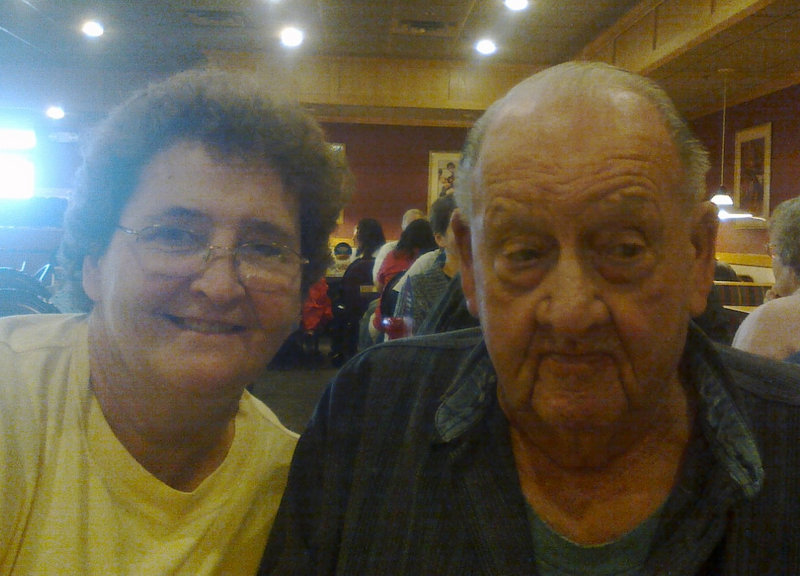 Linwood Weeman Sr. poses with his daughter Martha at their Thanksgiving Day dinner this year.