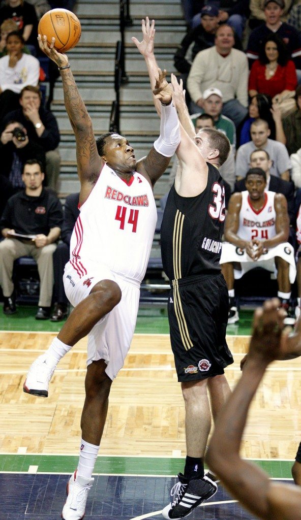 Tiny Gallon of the Maine Red Claws lifts a shot over Kyle Goldcamp of the Erie BayHawks during Maine s 120-107 victory Thursday night at the Portland Expo.
