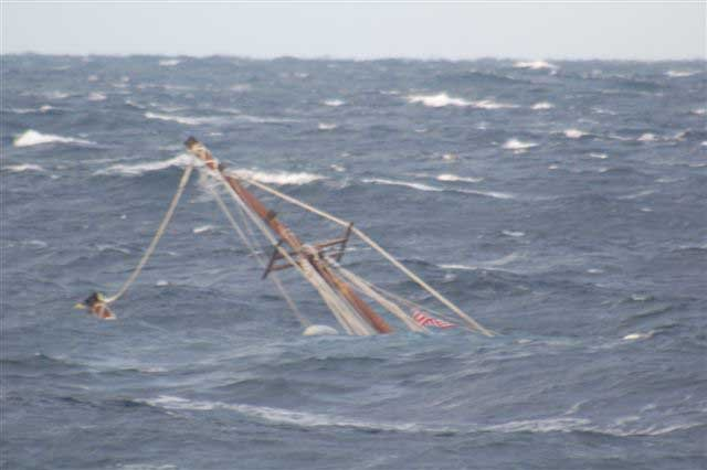 A mast of the 88-foot sailing vessel Raw Faith protrudes from the water as the boat sinks in approximately 6,000 feet of water about 166 miles southeast of Cape Cod, Mass., Wed., Dec. 8, 2010. The crew of the Kittery, Maine, Coast Guard Cutter Reliance remained on scene until the vessel sank. Coast Guard photo by Coast Guard Cutter Reliance crew.