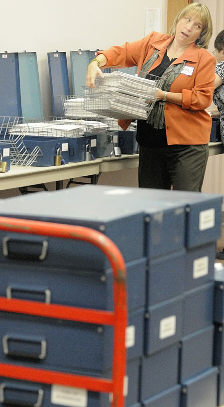 Staffers from Maine's Secretary of State's Office organize ballots today for counters to check during a rare statewide recount to recheck the outcome of a referendum on whether to allow a casino in Oxford County.