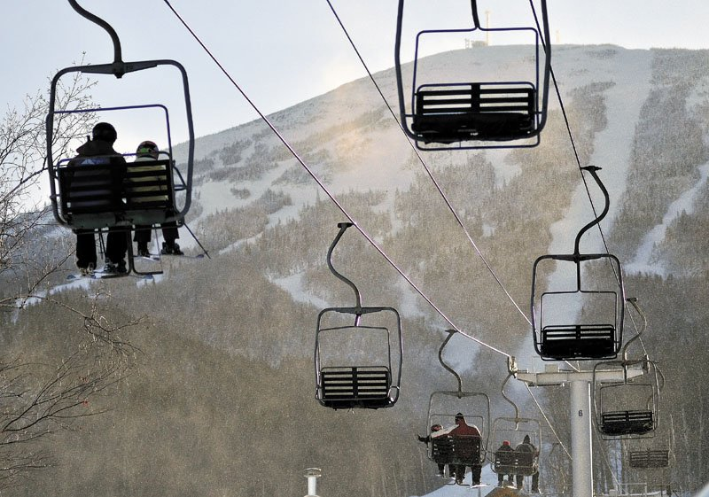 Skiers ride a chairlift at Sugarloaf. Another lift derailed on Dec. 28 in high winds, injuring eight people.