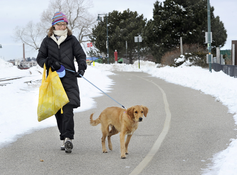 Annya Fischer and her dog Monty enjoyed a walk along the Eastern Prom Trail on Friday.
