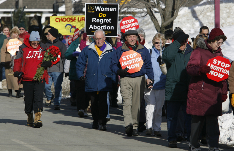 Participants in an annual anti-abortion rally march toward the state house today in Augusta for the