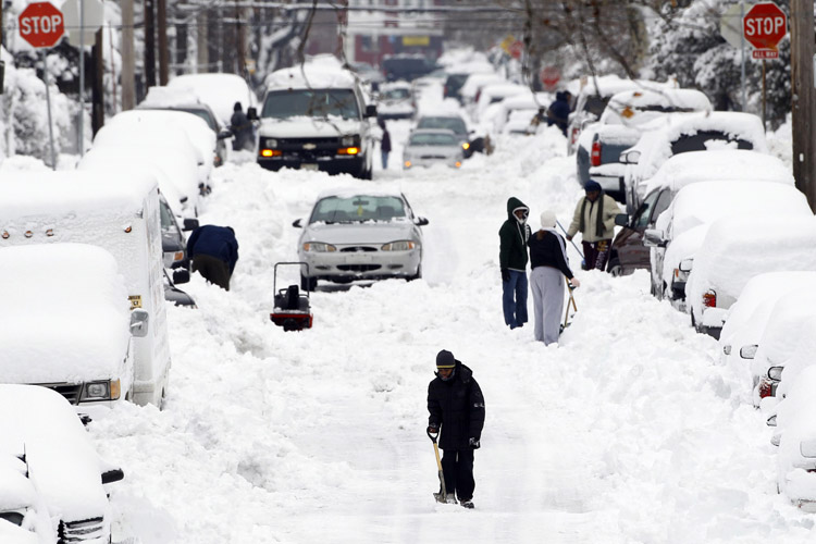 Philadelphians try to dig out in the aftermath of a winter storm that dropped 17 inches on the city.