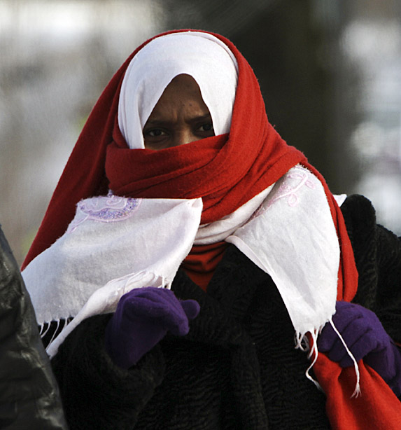 A woman bundles up against the cold in Lewiston today. People woke to temperatures of 20 degrees below zero, the coldest that most areas of Maine have seen in over two years.