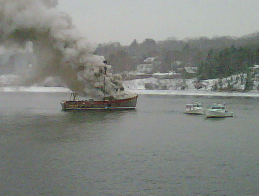 This photo taken by Gene Willard on his Blackberry shows the Debra Lee burning off the shore of Chebeague Island.
