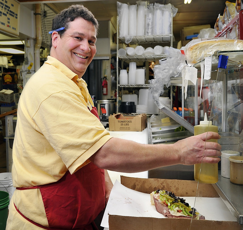 Sam DiPietro makes a roast beef Italian during lunch rush hour at DiPietro's Market in South Portland.