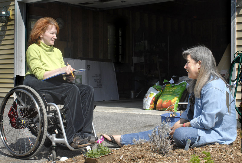 Kathy McInness-Misenor talks with Garden Angel volunteer Sue Tkacik at McInness-Misenor's home in this photo from 2007. Garden Angels are Master Gardeners who help the disabled and elderly tend their gardens.