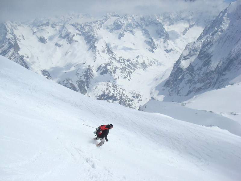 Warren Cook skis down a Swiss slope after climbing it.