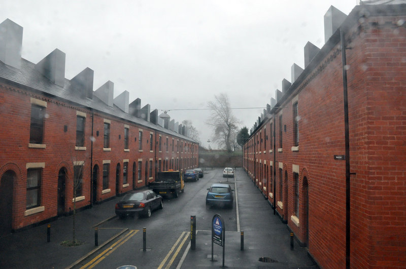 Much new housing in Manchester, England, is designed to resemble traditional street scenes.