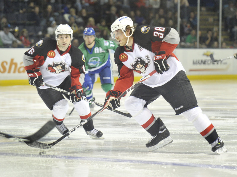 Tim Conboy of the Portland Pirates leads the rush into the Connecticut zone as teammate Brian Roloff skates in to help during the second period.