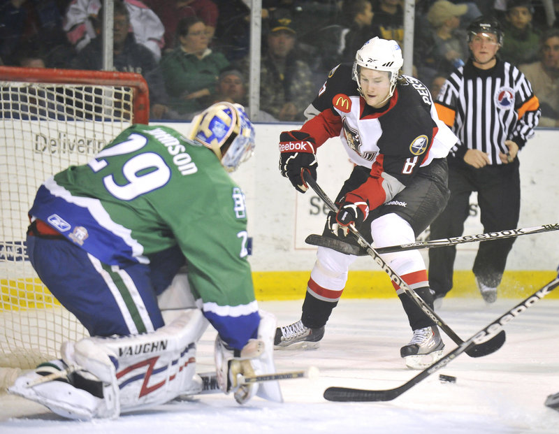 Chad Johnson, the goalie for the Connecticut Whale, keeps the near post covered Friday as Travis Persson of the Portland Pirates bears in during Connecticut s 5-4 overtime victory at the Cumberland County Civic Center.
