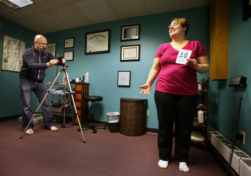 "Lou Jacobs photographs Dr. Lou's Weight Loss Challenge participant Denise Dyer of Biddeford for her ""before"" picture Saturday in Portland. Monetary prizes will be awarded based on greatest transformation and percentage of weight lost."