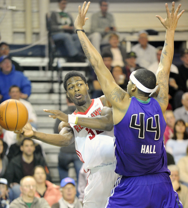 DeShawn Sims of the Maine Red Claws looks to pass Friday night while guarded by Mike Hall of the Dakota Wizards at the Portland Expo.