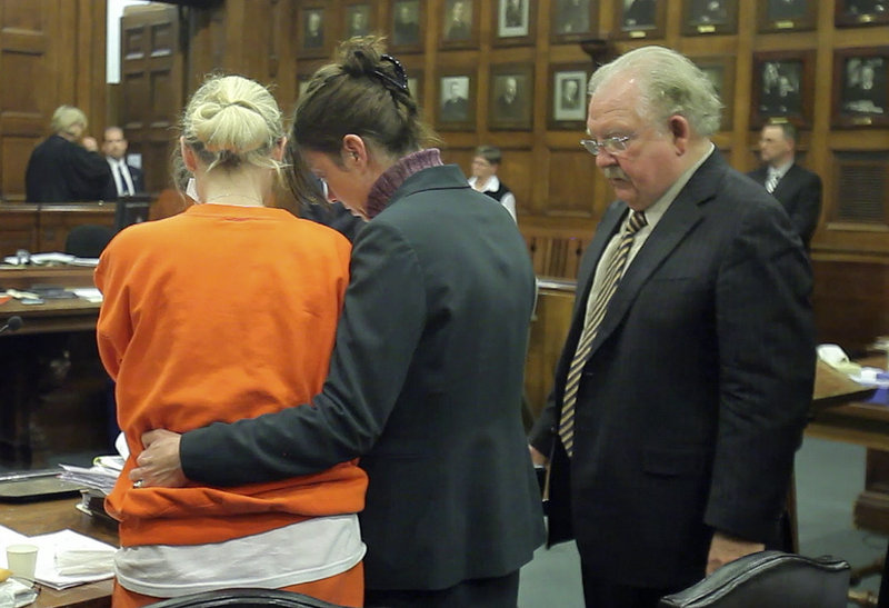 Attorneys Karen Wolfram, center, and Daniel Lilley, right, console Linda Dolloff after the sentencing on Friday.