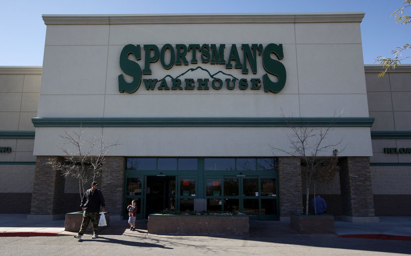 Customers leave Sportsman's Warehouse in Tucson, Ariz., on Tuesday. Police say Jared Lee Loughner, who's accused of shooting 20 people including U.S. Rep. Gabrielle Giffords, D-Ariz., bought the gun at the store in November.