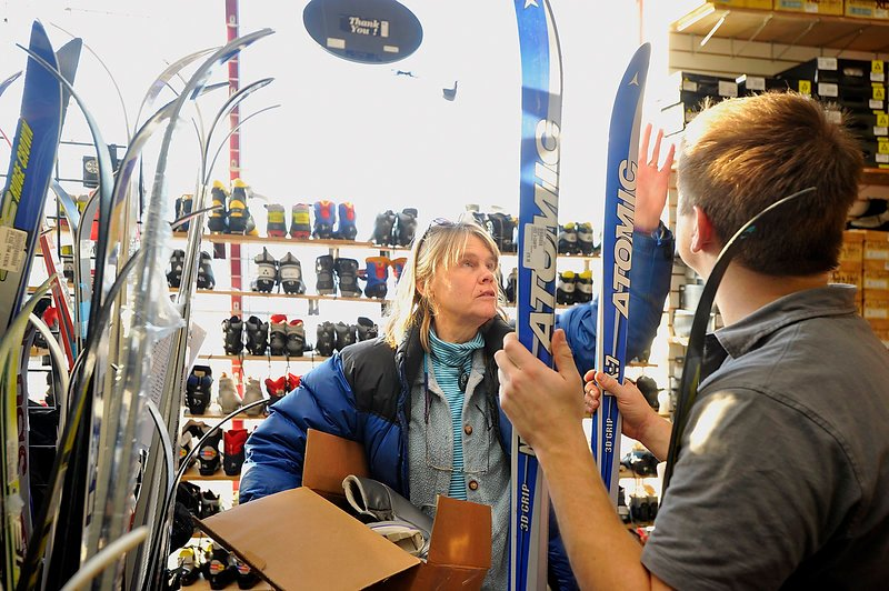 Nancy Krusell of Islesboro looks for a pair of cross-country skis Thursday at Play It Again Sports on Marginal Way, helped by assistant manager and salesman Nathan Leeman.
